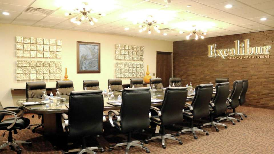 Image of chairs and table in boardroom.