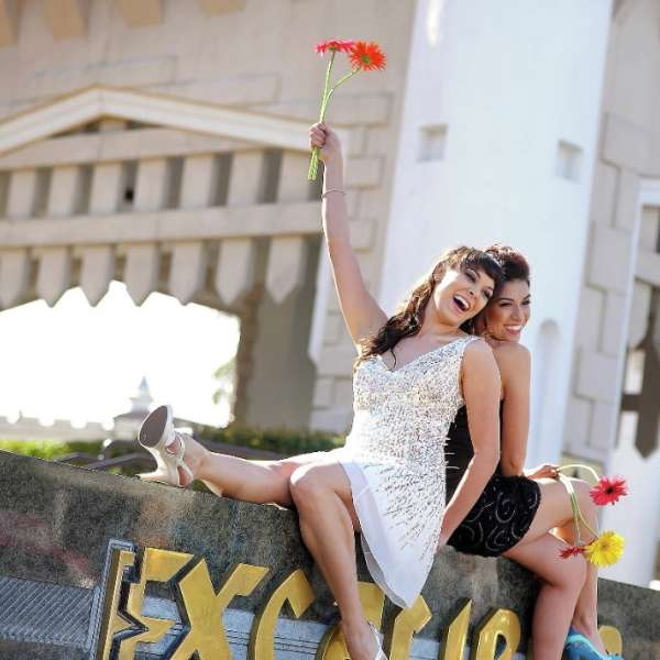 This is an image of a couple of girls posing for an outdoor wedding.