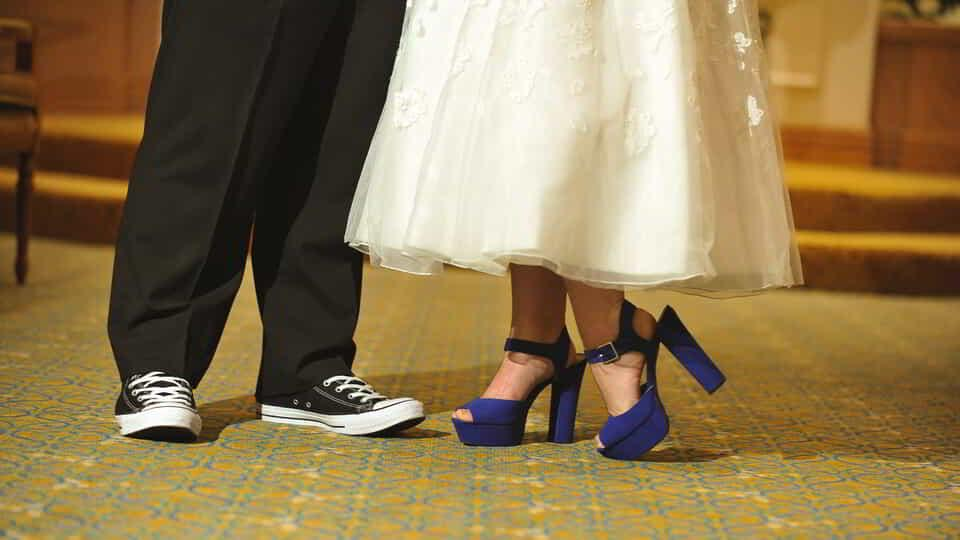 Wedding couple wearing shoes.