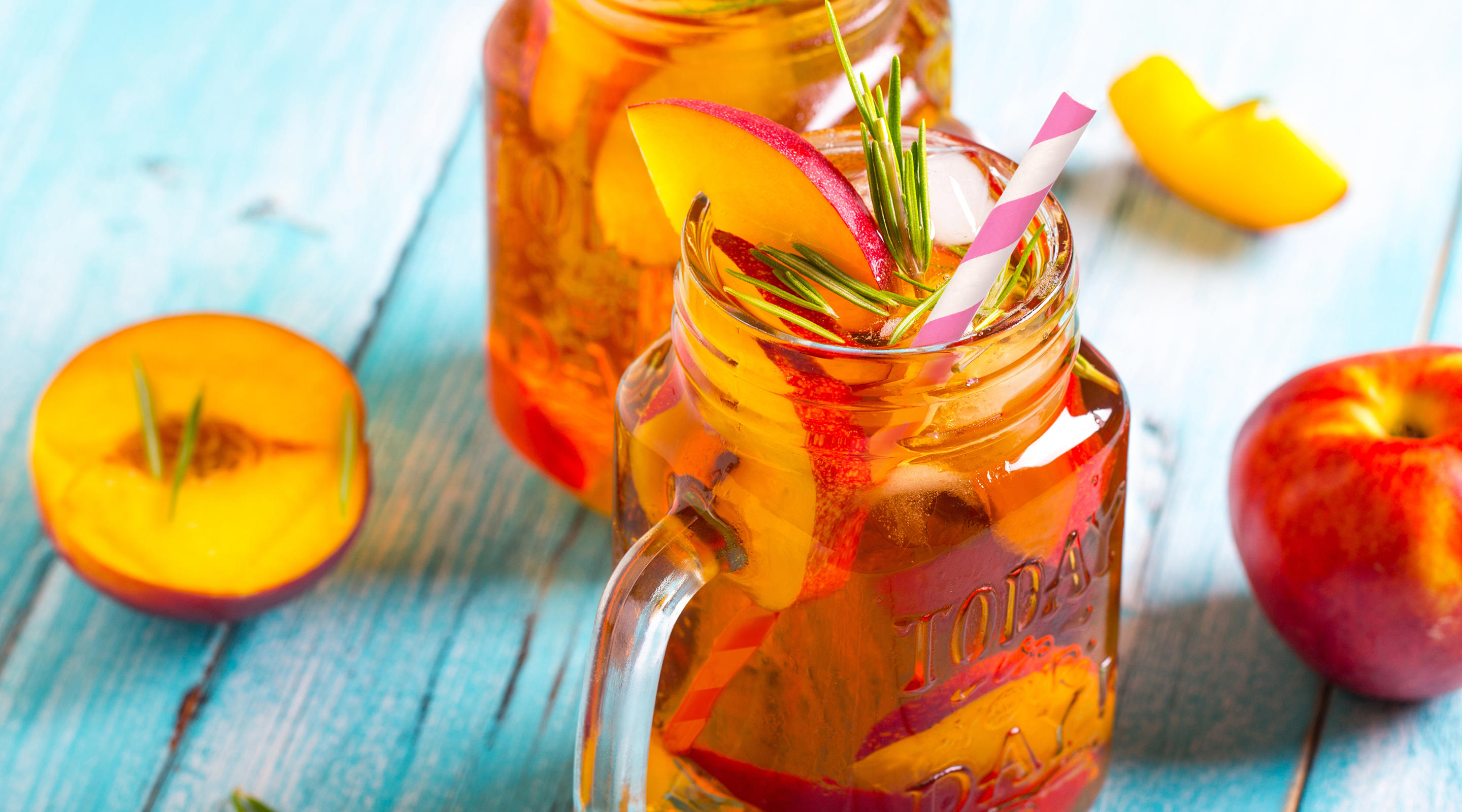 Fresh peach iced tea with mint and rosemary from Sweet Tea.