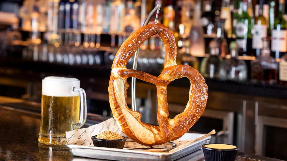 Bavarian Pretzel comes with Gouda cheese Sauce.