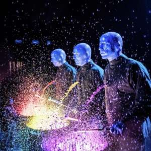 Paint splatters as the Blue Man Group drums.