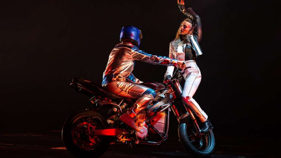 A fight on a motorcycle during R.U.N produced by Cirque du Soleil.