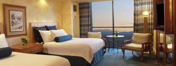 Tower Deluxe Rooms are outfitted with your choice of two queen beds or one king bed, flatscreen TV, separate shower and bath, and marble countertops. Sinfully stunning views and beautiful accommodations take relaxation to its peak.