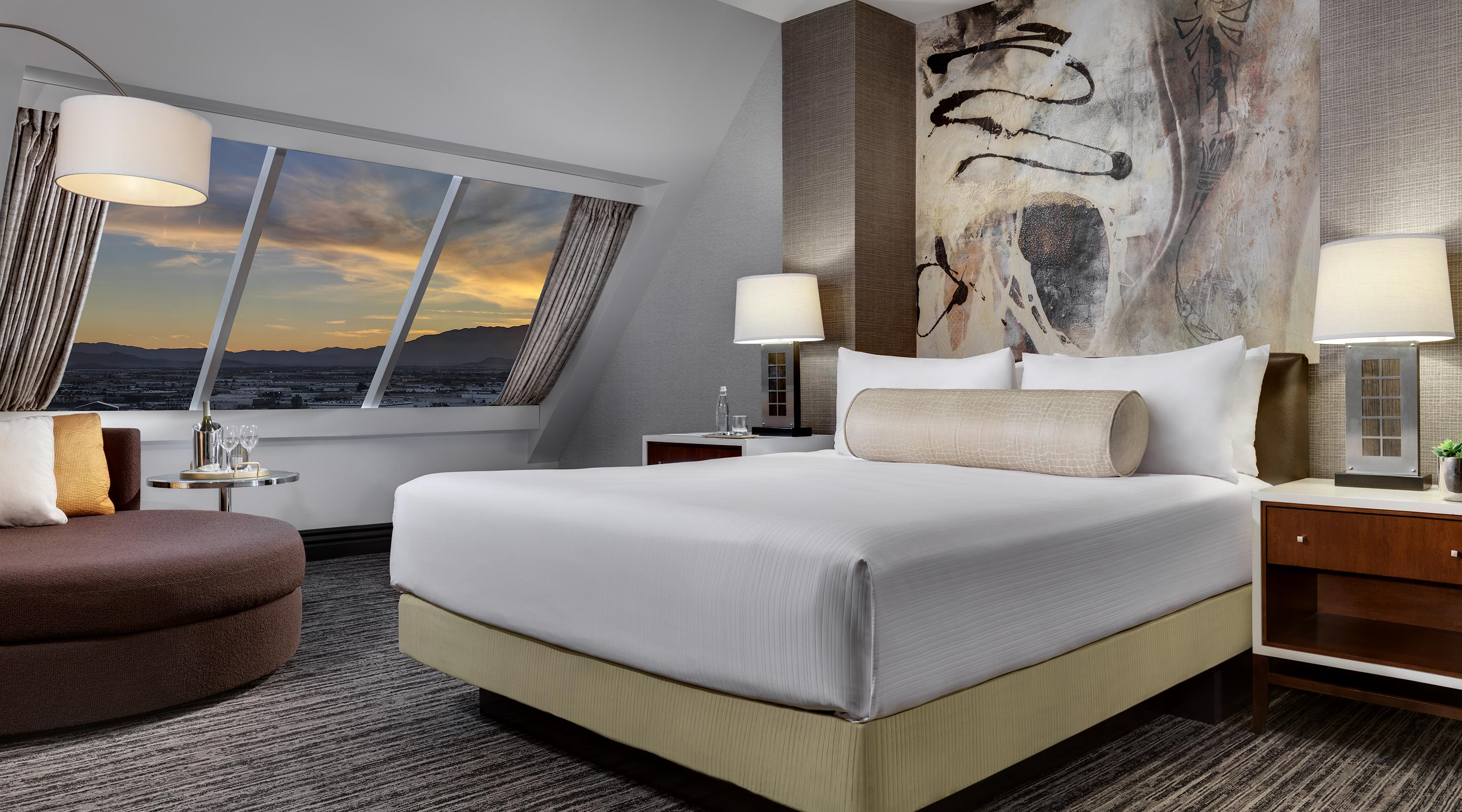 King sized bed in the Pyramid Premier Suite Bedroom.