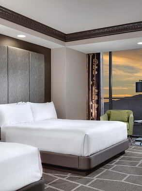 Image of the remodeled Tower Premium Queen Room with a mountain view.