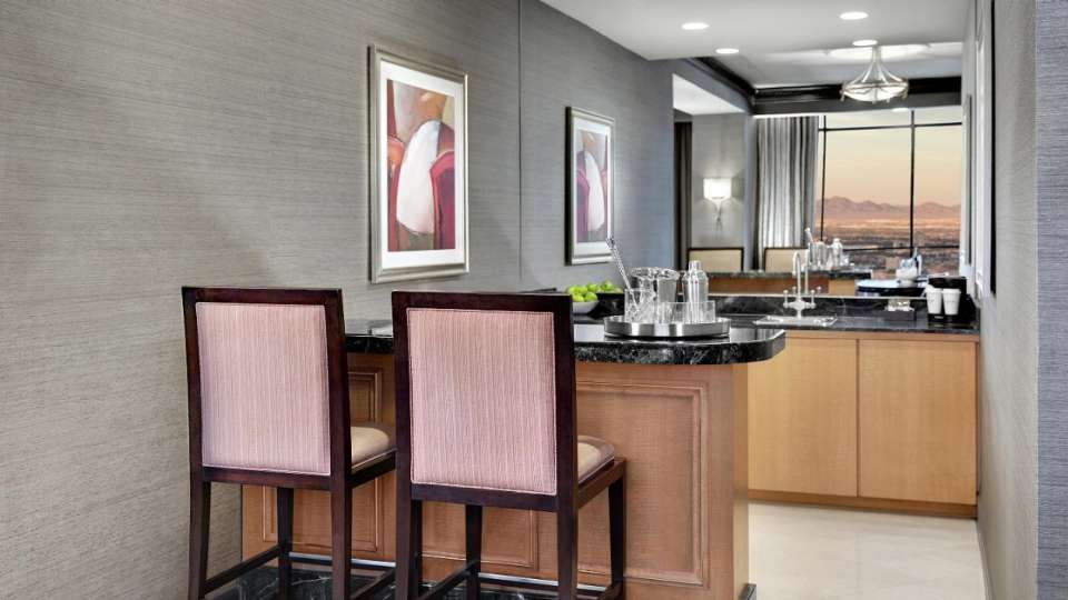 Wet bar with two chairs in Tower Premier Suite.