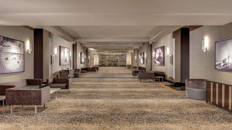 Our wide hallway with seating inside our convention space. is perfect for your next event.