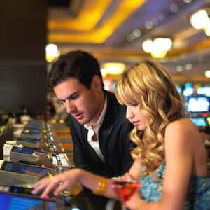 mandalay-bay-casino-couple-playing-video-poker.tif.image.300.300.high