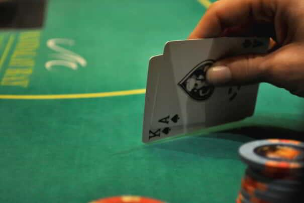 A poker player finds himself in good luck when he checks his hand.