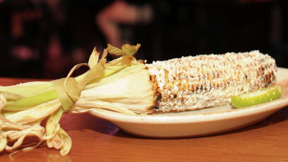 Grilled Corn Lightly Brushed with Mayo-Butter and Sprinkled with Cotija Cheese and Chili Flakes