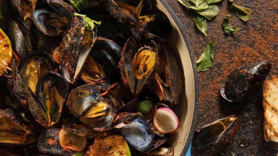Libertine Social, located at Mandalay Bay, presents their Harissa Rubbed Mussels.