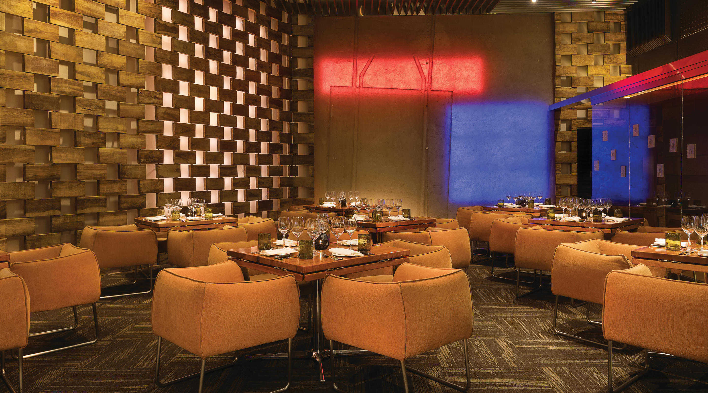 Interior dining area with wall lighting at Stripsteak.