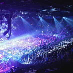 Panoramic image of Mandalay Bay Events Center with crowd and act performing on stage
