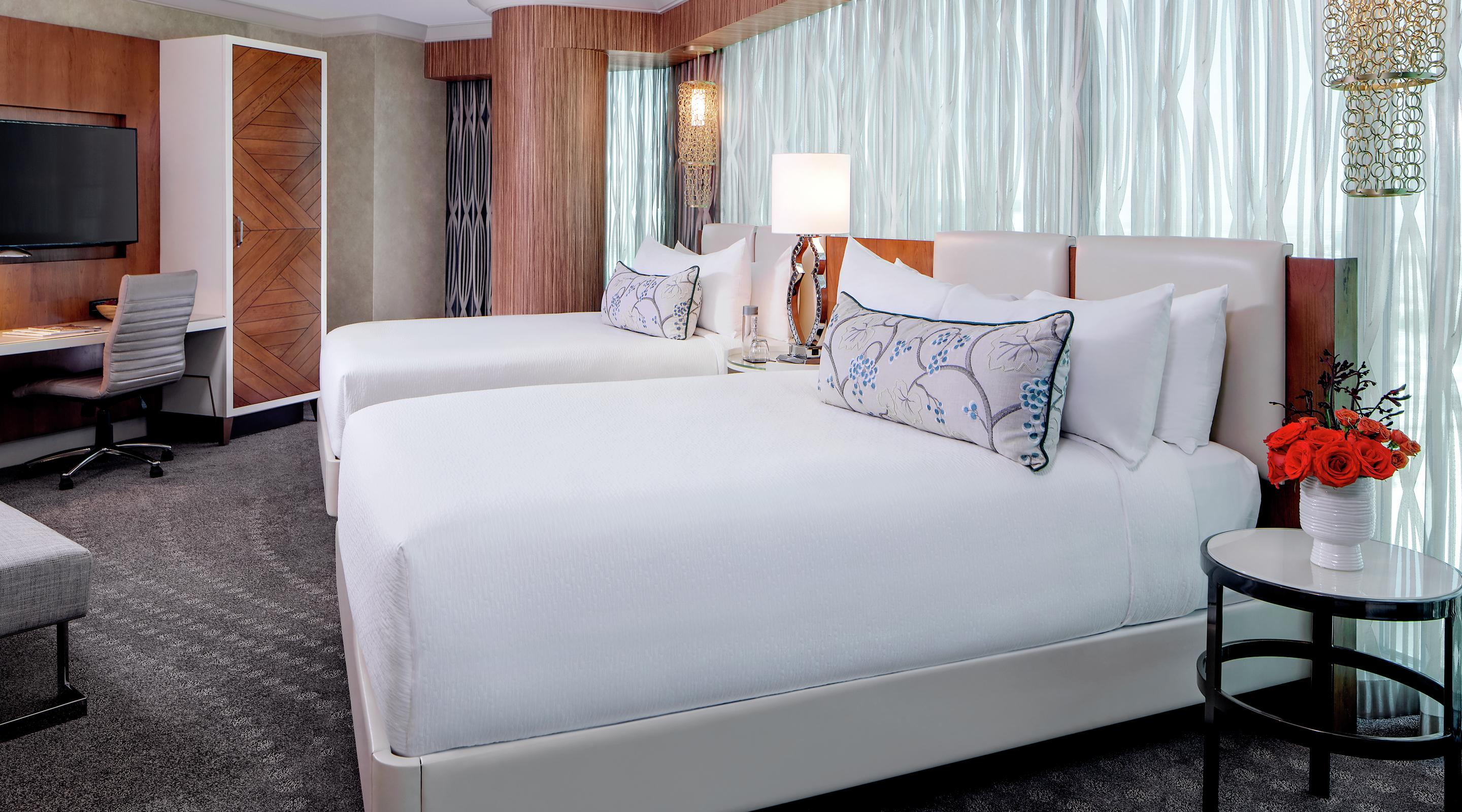 Modern simplicity and true comfort unite in our newly remodeled Two-Bedroom Queen Suite with views of the Las Vegas skyline.