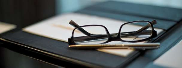 Glasses on a notepad.