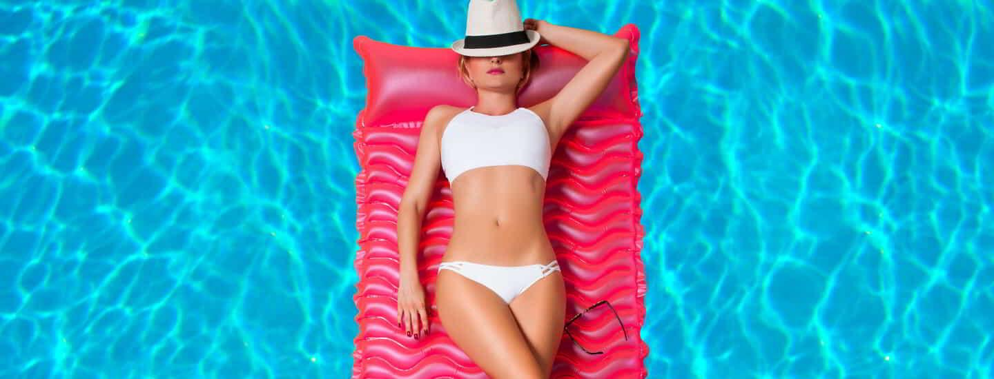 A woman lay down on the rubber raft.