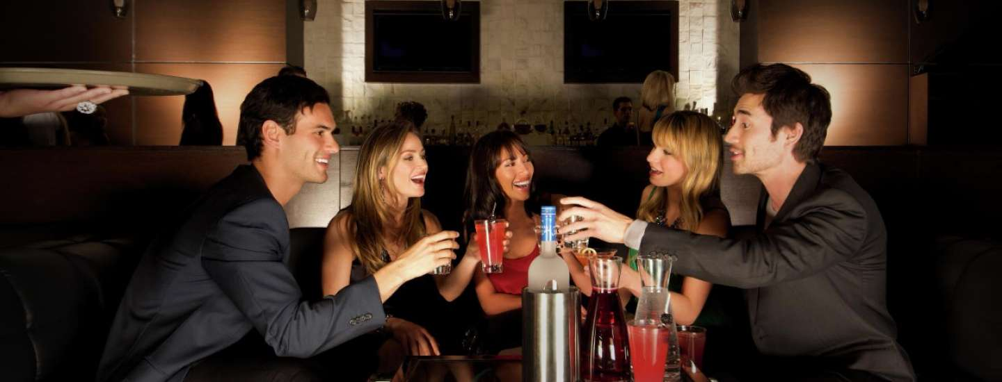 A group of friends share drinks and stories at Eyecandy.