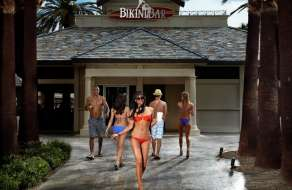 Guest walking from the Bikini Bar entrance at Mandalay Bay Beach.