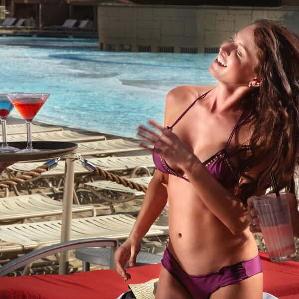 Girl receiving drinks from the server at the Wave Pool inside Mandalay Bay Beach.