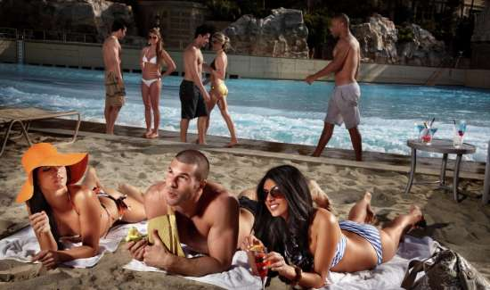 mandalay-bay-pools-beach-lifestyle-girls-with-guy-in-sand.tiff.image.550.325.high