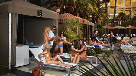 Group of ladies hanging out and enjoying themselves at one of the cabanas inside Mandalay Bay Beach.