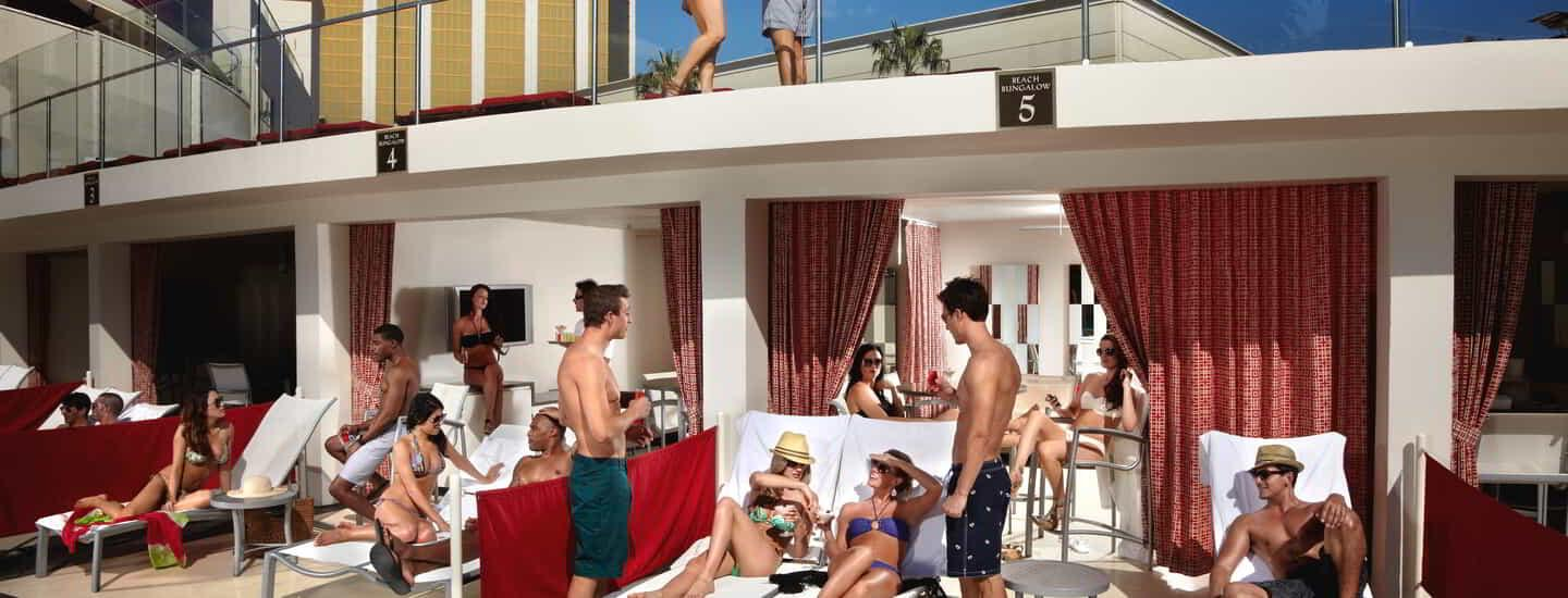 People enjoying the cabanas at Mandalay Bay Beach ground level.