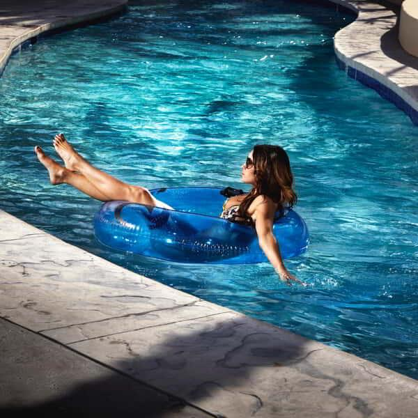 Women relaxing and traveling down the lazy river at Mandalay Bay Beach in an inner tube.