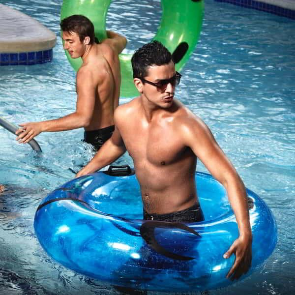 Guest exiting the lazy river with his inner tube at Mandalay Bay Beach.