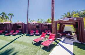 Moorea cabanas and lounge chairs on lawn.