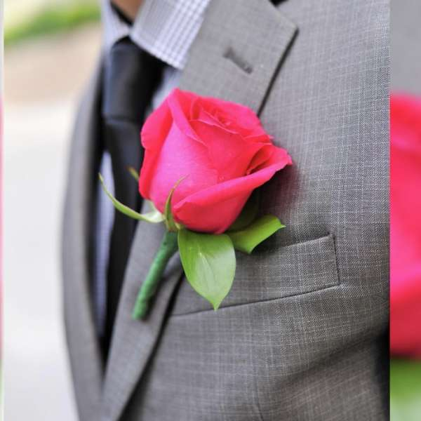 mandalay-bay-weddings-services-boutonniere-hot-pink-on-gray-suit