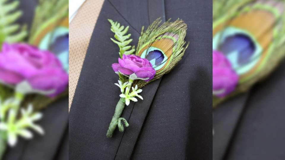 mandalay-bay-weddings-services-boutonniere-purple-with-feather