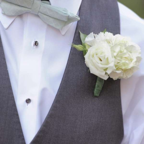 mandalay-bay-weddings-services-boutonniere-white-carnations-rose