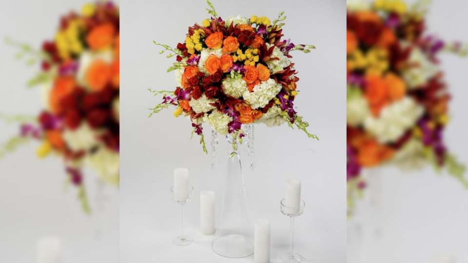 Complete your wedding decor with an orange floral centerpiece