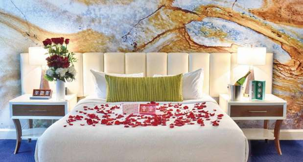 Roses and floral arrangements on the bed.