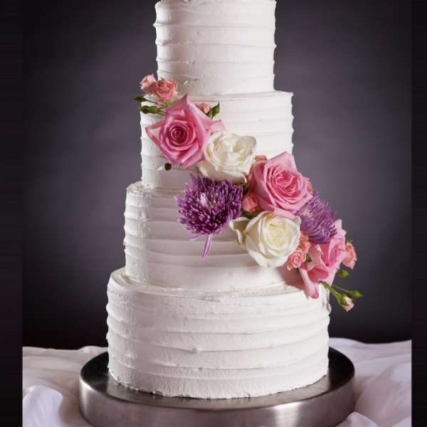 mandalay-bay-weddings-cake-four-layer-pink-white-purple-flowers
