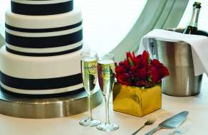 Wedding cake with glasses of champagne.