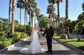mandalay-bay-amenities-weddings-couple-in-front-of-hotel