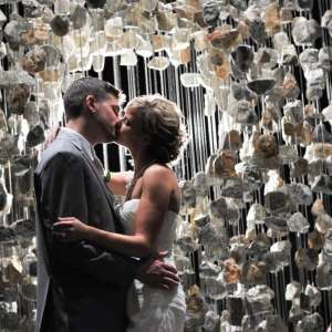 Wedding couple kissing in front of Gallery inside Delano Las Vegas