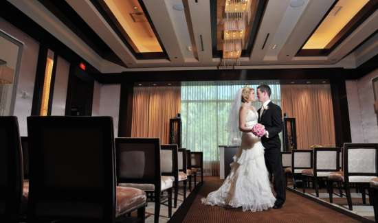 mandalay-bay-weddings-chapel-couple-in-isle.tif.image.550.325.high