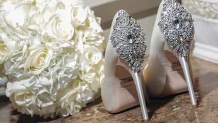 mandalay-bay-weddings-chapel-lifestyle-bride-shoes-and-bouquet
