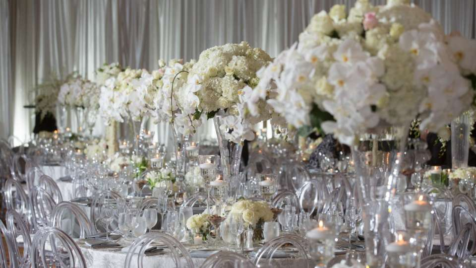 All white flowers wedding tables.