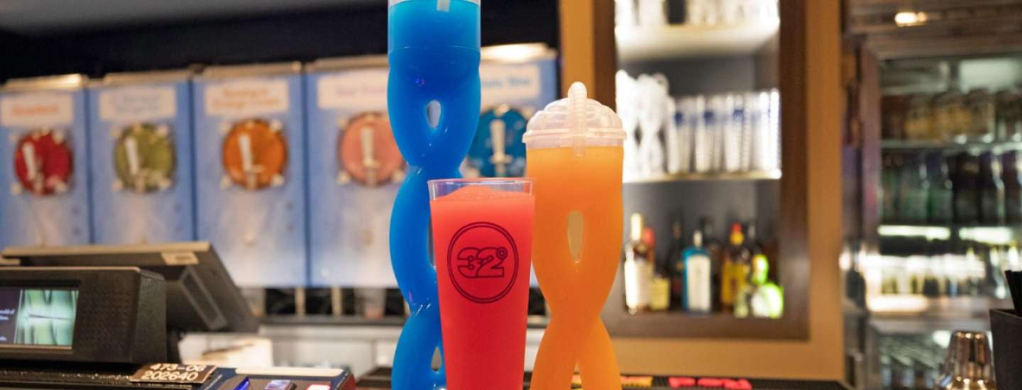 32° Daiquiri Cups on Counter with machines in the background.