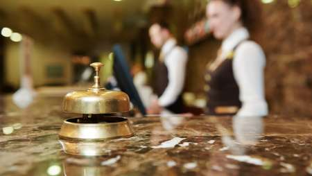 Image of a bell on the concierge desk
