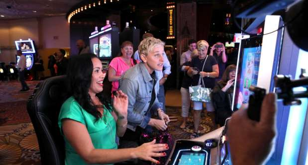 Ellen surprises guests playing her slot machine in the casino at MGM Grand.