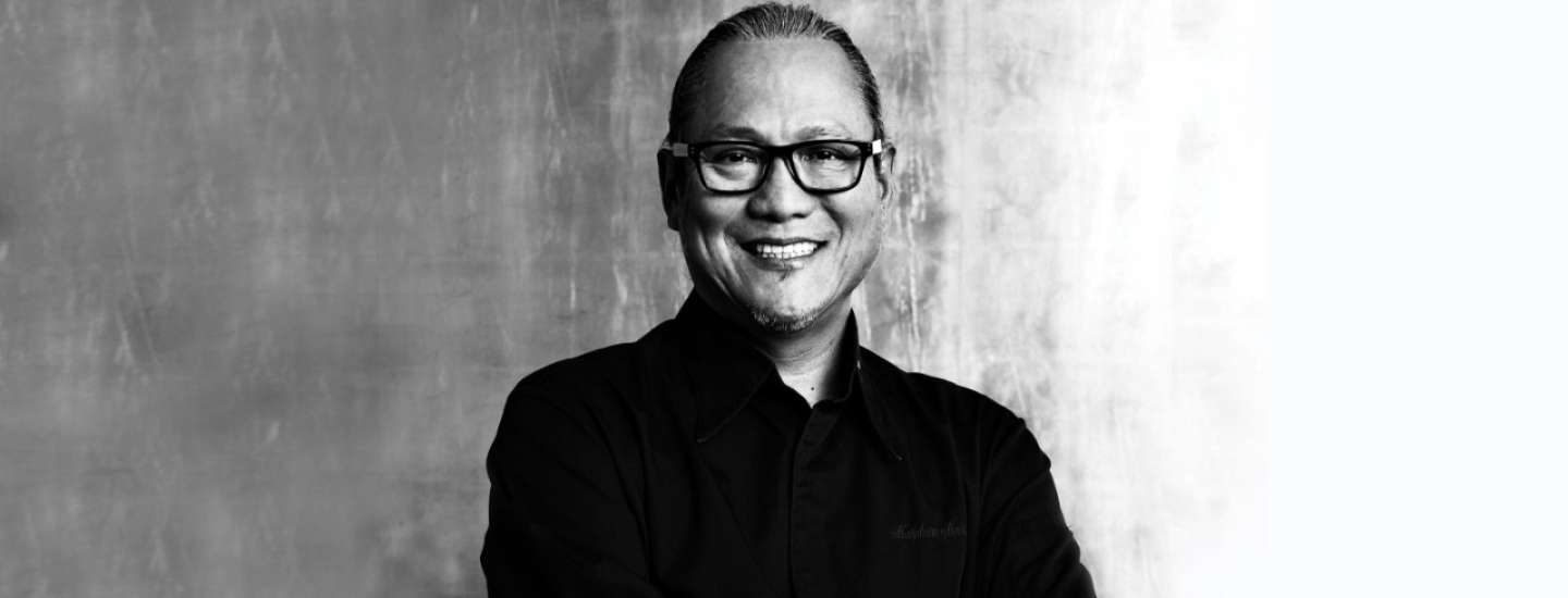 Chef Masaharu Morimoto with his arms crossed.