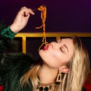 Lady eating spaghetti.