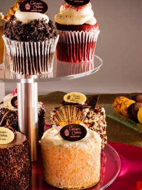 A display of cupcakes, mini-cakes, macaroons and more at Corner Cakes