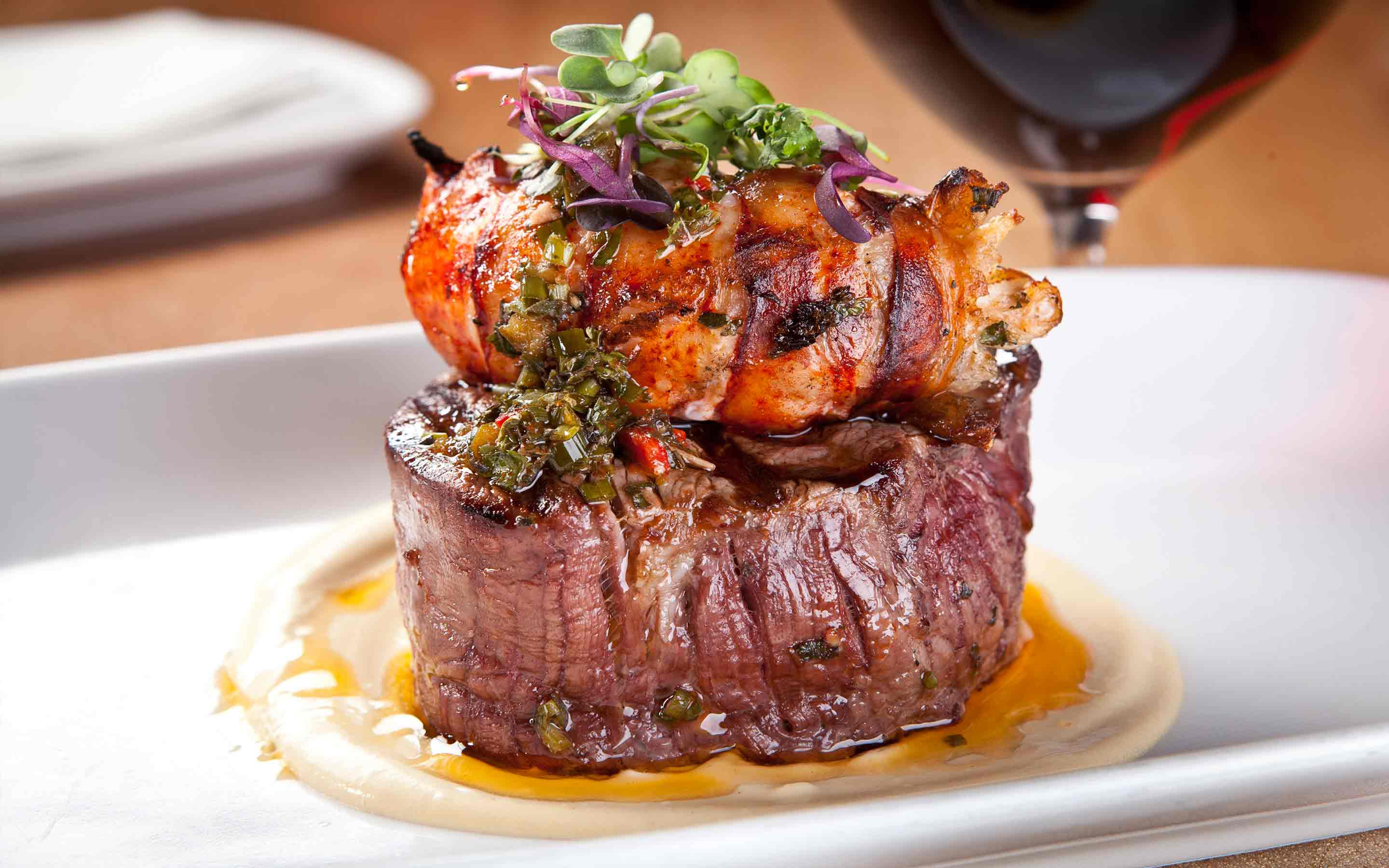 Surf & Turf  has Beef Filet, Lobster Tail, and Chimichurri Vinaigrette at Crush.