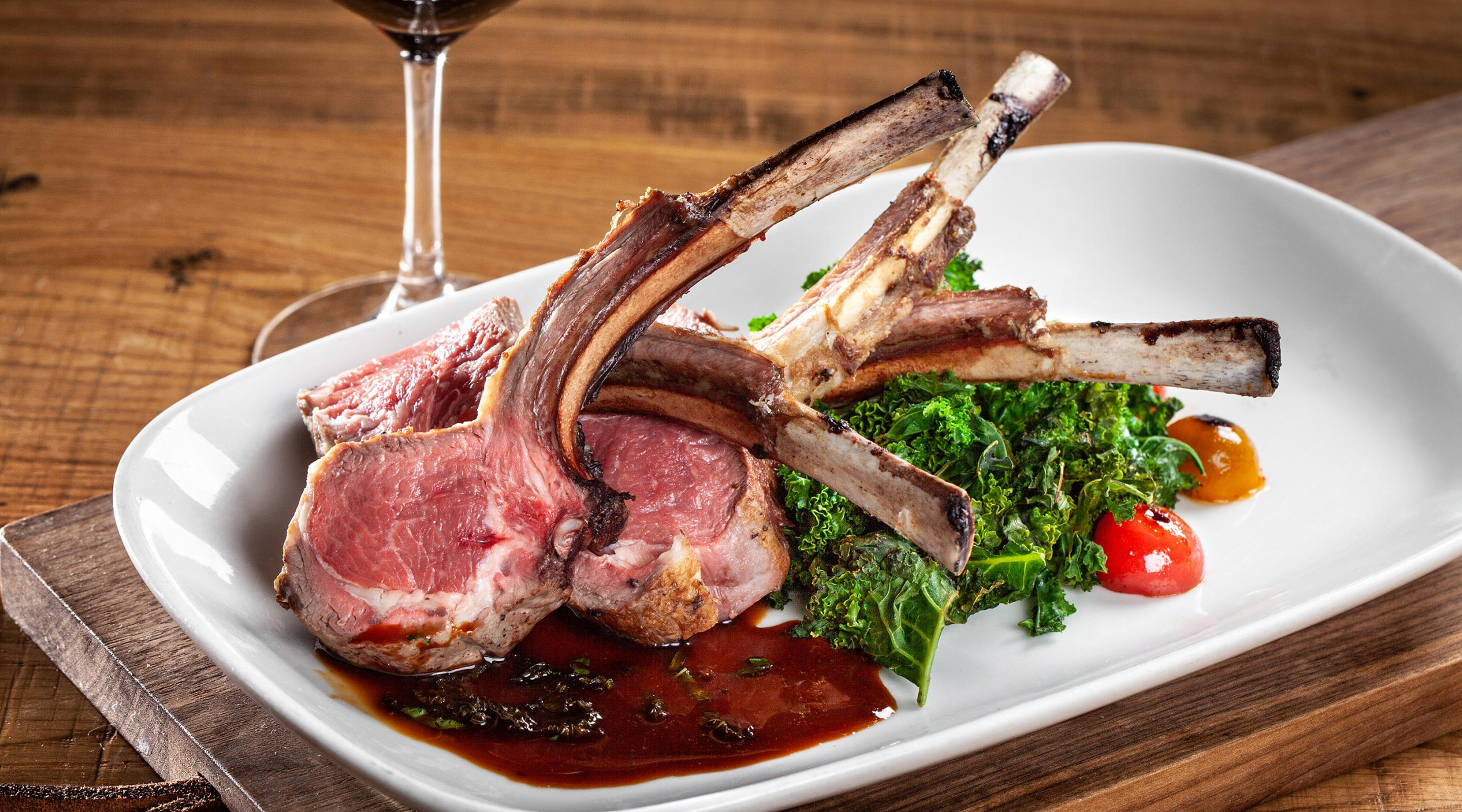 Rack of Lamb with braised kale, cherry tomatoes, mint.